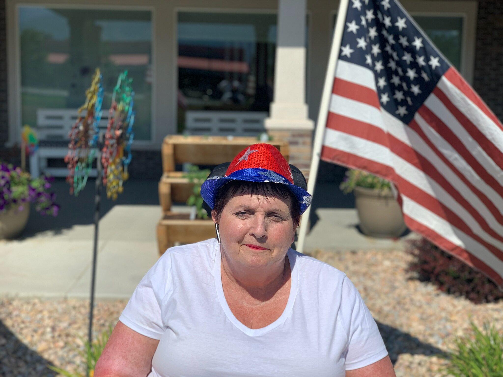 Photo of Donna McCormick with American Flag in the background