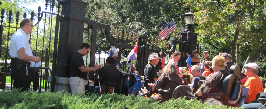 Photo shows ADAPT members at a protest